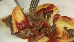 Cutting Meat Pie With Ketchup Stock Footage