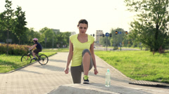 Woman stretching leg before jogging, super slow motion, shot at 240fps HD Stock Footage