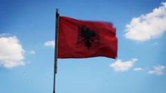 Waving flag of Albania on blue sky Stock Footage