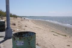 Garbage Can on beach - stock photo