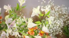 Flowers on decorative basket Stock Footage