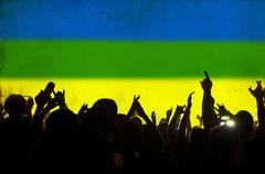 cheering crowd and the colors of the brazil flag - stock illustration