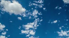 Stock Video Footage of puffy white clouds crisp blue sky time lapse establishment shot
