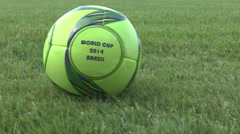 Soccer ball on grass field of the stadium Stock Footage