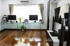 Modern office with computer and labtop with home theater Stock Photos