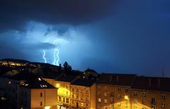 big flash in night thunderstorm in city - stock photo