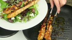 Serving Chicken Kebabs With Salad Stock Footage