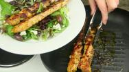 Stock Video Footage of Serving Chicken Kebabs With Salad