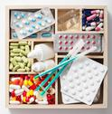 Stock Photo of medical pills and ampules in wooden box
