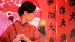Asian Japanese Female Red Kimono Parasol Tourism Advertising Stock Footage