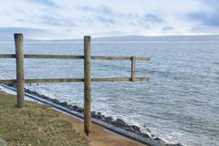 February 14 storm damage 2014, wooden fence suspended where cliff washed away Kuvituskuvat