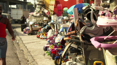 Street sellers goods piled high. Young women pass by Stock Footage