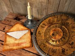 mystical concept still life with zodiac sighs, candle and letter - stock photo