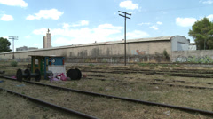 Railway tracks beside shanty town Stock Footage