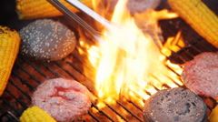 Making burgers and vegetables on barbecue grill Stock Footage