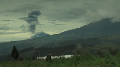 Tunguragua Volcano spews ash cloud, peasant woman walks away Stock Footage