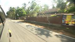 Minivan overtaking other minivan on the small country roads of Sri Lanka. Stock Footage