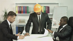4K & HD resolutions: the builders discuss the project in the office Stock Footage