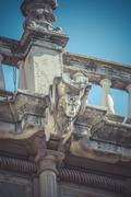 culture, stone gargoyle on the facade of the university of alcala de henares, - stock photo
