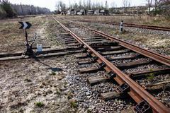 railroad tracks and railroad switch - stock photo