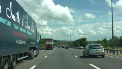 front view of cars going past, m6 motorway in summer - stock footage