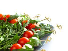 Appetizer with mozarella tomato and arugula Stock Photos