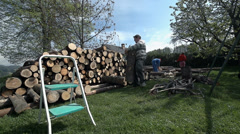Carrying log to pile for stock Stock Footage