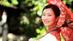Stock Video Footage of Japan Travel Tourism Female Asian Japanese Costume Red Kimono Parasol