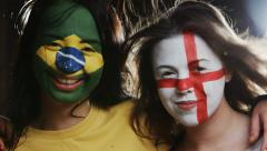 Two happy female soccer fans look at the camera Stock Footage