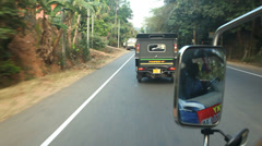View of two auto rickshaws from a moving car. Stock Footage