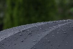 Black umbrella with raindrops - stock photo