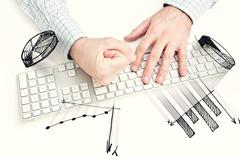 Angry businessman hitting computer keyboard Stock Photos