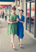 urban scene with young women - stock photo
