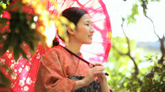 Asian Japanese Female Red Kimono Parasol Tourism Advertising - stock footage