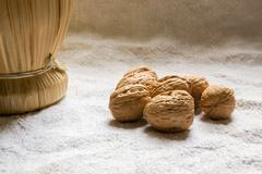 Set with some walnuts and a wine bottle Stock Photos