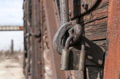 Old latch and padlock - stock photo
