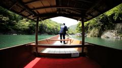 Boatman Katsura River tourist people travel Arashiyama Kyoto Japan Stock Footage