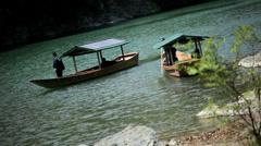 Riverboat Katsura River tourists travel Arashiyama Kyoto Japan Asia Stock Footage