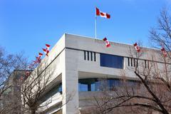 Canada flags embassy pennsylvania ave washington dc Stock Photos