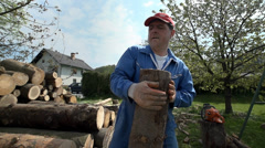 Woodworker throwing log on pile in slow motion Stock Footage
