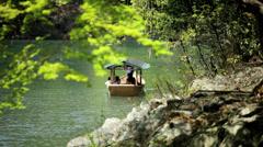 Japanese tourist boat scenic beauty travel Arashiyama Kyoto Japan Stock Footage