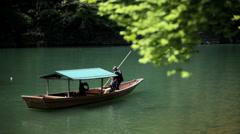 Boatman Katsura River tourists travel nature Arashiyama Kyoto Japan Stock Footage