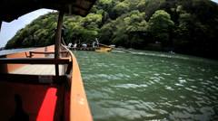 Stock Video Footage of Riverboat Katsura River tourists travel Arashiyama Kyoto Japan Asia