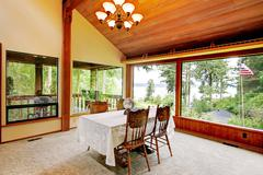 Dining room in log cabin house Stock Photos