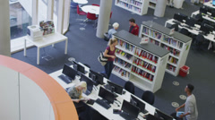 Student group working with teacher in modern college library - stock footage