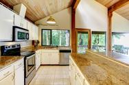 Stock Photo of kitchen room in log cabin house with walkout deck