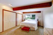 Stock Photo of bedroom interior in log cabin house