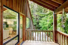 Walkout deck in log cabin house Stock Photos