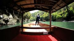 Boatman Katsura River tourist people travel Arashiyama Kyoto Japan - stock footage