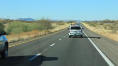 Vehicles Pass Sheriff's Patrol Car Stock Footage